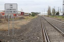 'End CSR locomotive coasting only' sign for down trains departing the Francis Street level crossing