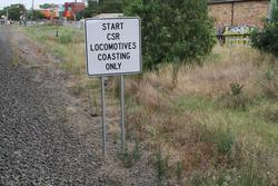 'Start CSR locomotive coasting only' sign for up trains approaching the Francis Street level crossing