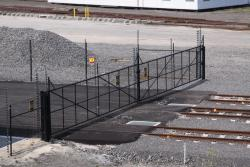 Rail access gate to the new Sadleirs Logistics depot, the electric fence carries across
