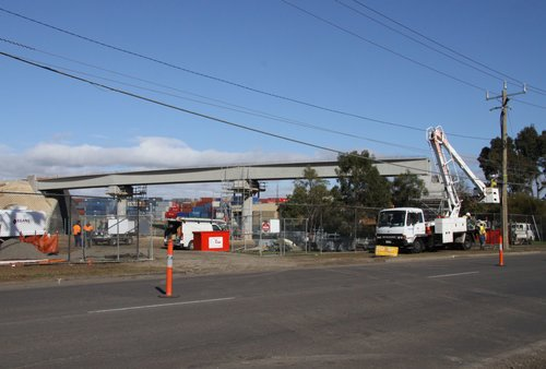 Three spans already in place, work on relocating power lines