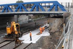 Removing the remains of the former bridge, to make room for the new RRL tracks to pass beneath