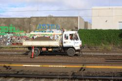 Hi-rail truck delivering ballast near Albert Street