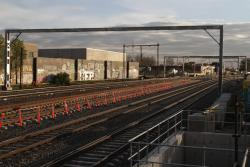 New six track wide gantries in place, but overhead still supported by the old structures