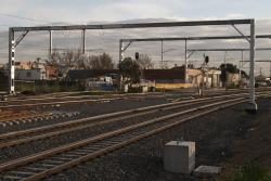 Overhead on the suburban tracks supported by the new six track wide gantries