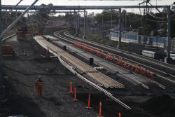 Suburban tracks removed, replaced by a new track pair to make room for the future RRL tracks