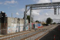 RRL tracks in place right behind the back walls of industrial properties