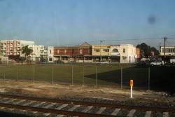 Works compound off Buckley Street removed, with the land fenced off then replanted with grass