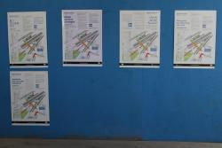 Posters advertising the new station layout in five different languages