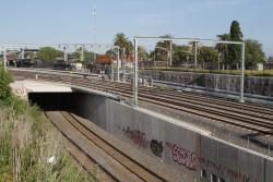 Dual gauge freight tracks pass beneath the suburban and RRL tracks via a new bridge