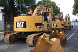 Excavators lined up along the closed section of Irving Street