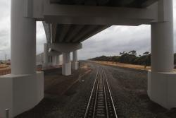 West broad gauge track passes beneath the flyover