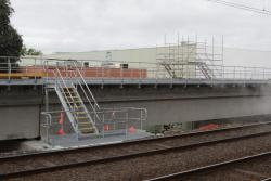 Steel staircase linking the existing tracks and the new RRL viaduct