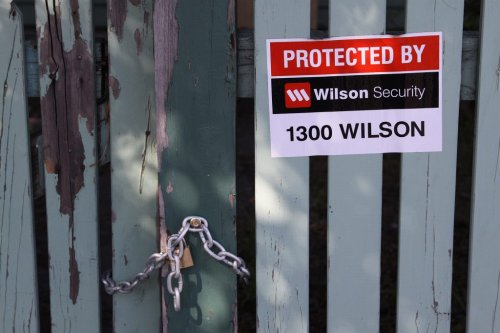 Chained up front gate and Wilson Security sticker, 43 Windsor Street