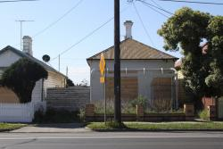 152 Buckley Street, vacant and boarded up