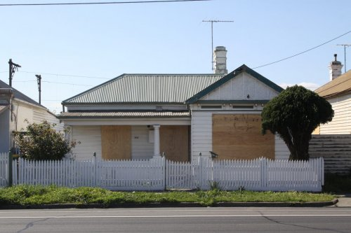 154 Buckley Street, vacant and boarded up