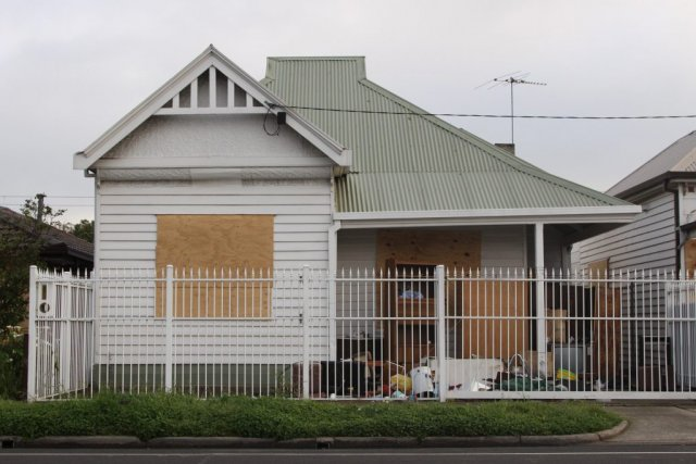 164 Buckley Street, vacant and boarded up, abandoned furniture on the front lawn