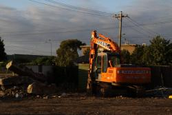 Excavator ready to clean up the last of the concrete
