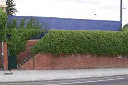 Compulsorily acquired properties at Middle Footscray: Blue fence where the terrace houses on Victoria Street used to be