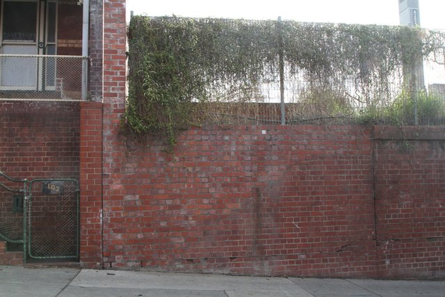 Bricked up wall where the stairs to the Victoria Street terrace houses used to be