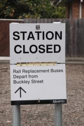 Fold down 'Station Closed / Rail  Replacement Buses depart from Buckley Street' sign