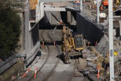 Excavator down on the lower level goods lines
