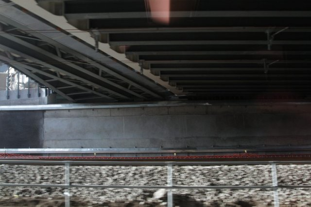 Underside of the bridge - a curved span to the left, and the main span with traverse girders in the middle