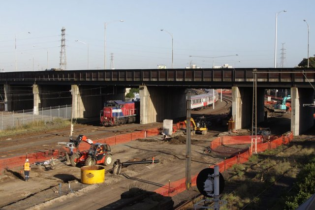 Preparation work continues beneath the Dynon Road overpass