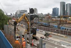 Install supports for future noise walls along the edge of the rail corridor