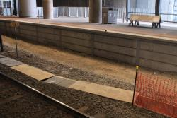 Plywood covers signal trunking between at Southern Cross platforms 14 and 15