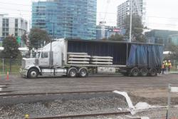 Unloading concrete sleepers from a tautliner trailer