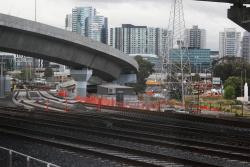 Track pair towards Southern Cross platforms 1 through 8 skirts around the west side of the Melbourne Yard sidings