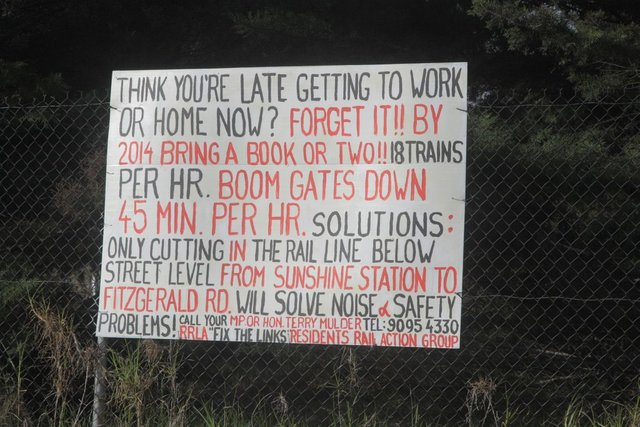 Posters from the 'Fix the Links' Residents Rail Action Group at the Fitzgerald Road level crossing