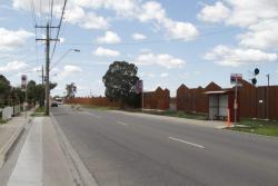 Ardeer station hides behind steel noise walls parallel to Forrest Street