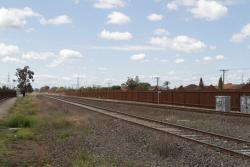 Tracks towards the city from Ardeer station also enclosed by steel noise walls