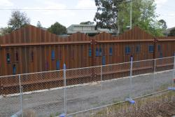 A few token peepholes in the steel noise wall at Ardeer station