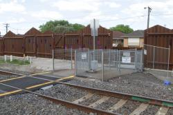 Pedestrian crossing at Ardeer station, hidden among the steel noise walls