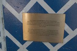Plaque explaining the artwork by Sam Songailo at the entrance to Tottenham station