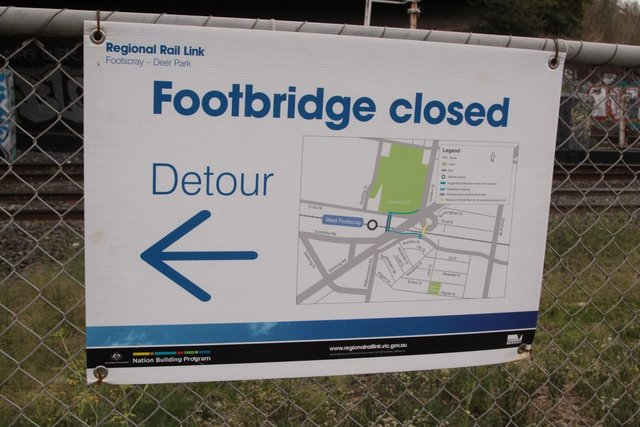 Poster at the Rising Sun footbridge directing passengers to the detour route