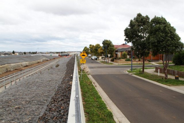 Looking south along the completed concrete crash barrier along Clarence Street