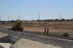 Wyndham Vale Stabling: Track gang at work on the lead into the new sidings