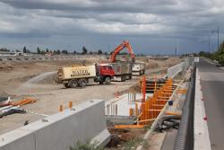 Construction equipment working on the cutting at Wyndham Vale station