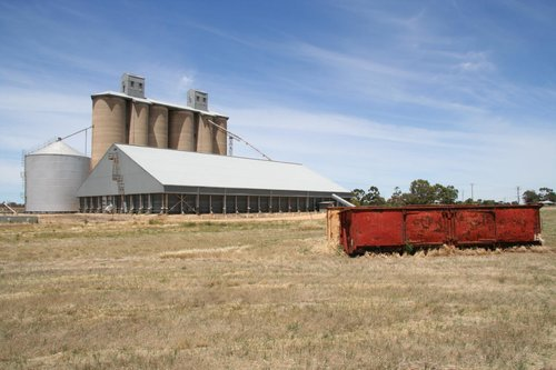 Pair of GYs abandoned in the paddock beside the grain silos