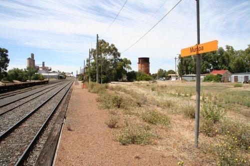 Orange V/Line signage on the passenger platform